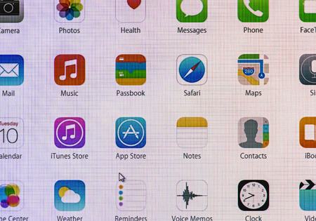 Moscow, Russia - September 24, 2014: operating system of Apple iOS 8 homescreen. iOS 8 mobile operating system designed by Apple Inc. is an upcoming September 17, 2014.