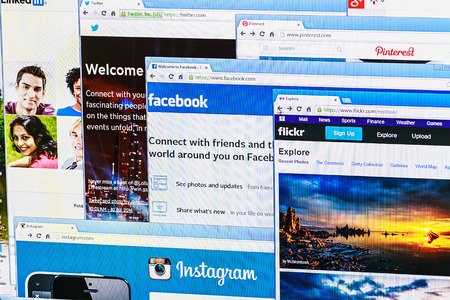Moscow, Russia - August 26, 2014: Photo of Pinterest, Twitter, Facebook, Google+, Linkedin, Flickr and Instagram homepage on a monitor screen. This is the most popular social network in the world.