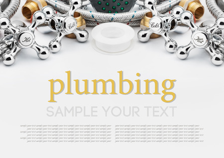 All kinds of plumbing and tools on a gray background  photo