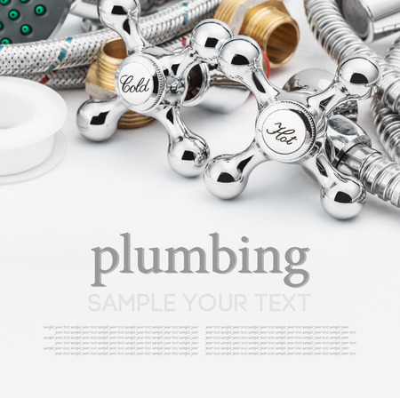 plumbing and tools on a light background. Empty white space above and below for sample background and text photo