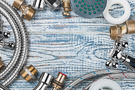 plumbing and accessories on wooden table background