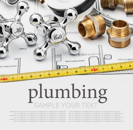 plumbing: plumbing and tools on a gray background. Empty white space for sample background and text