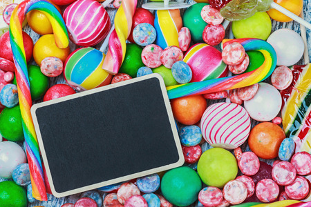 blackboard for writing greetings on a lollipop and sweets photo