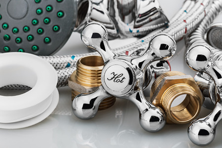 plumbing and tools on a light background