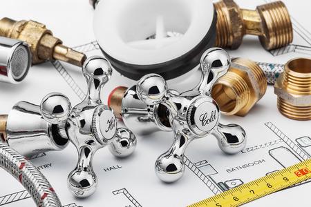 plumbing repair: plumbing and tools lying on drawing for repair