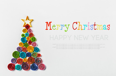 Christmas tree made of paper made by Quilling. inscription is a sample text for congratulation photo