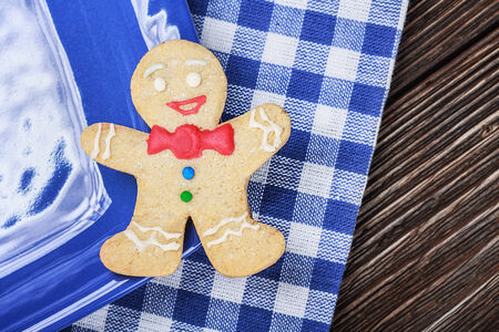 Smiling gingerbread men nestled in holiday the background of Christmas decorations photo