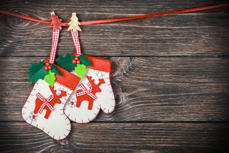 Christmas stocking hanging on the wooden background