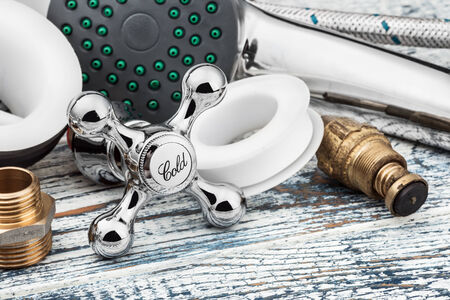 plumbing accessories: plumbing and accessories on wooden table