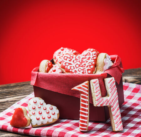 Valentines Day cookies on a red background photo