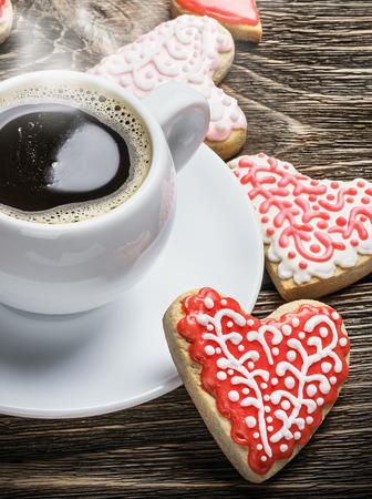 Heart shaped cookies baked on valentines day and a cup of coffee photo