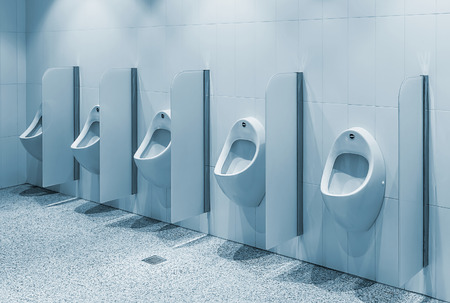 toning: urinals in a public toilet, background. toning