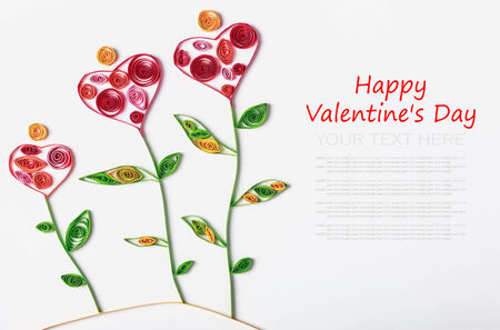 quilling: flowers made of paper quilling technique. Congratulations to the St. Valentines Day or Mothers Day Stock Photo