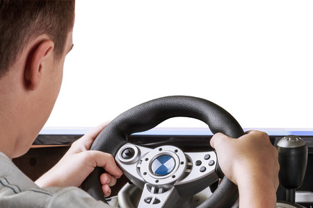 gamer playing in the race behind the wheel isolated on white background