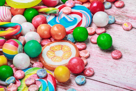 ollypop and chewing gum on a wooden table photo