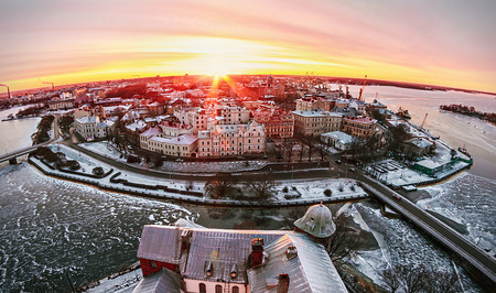 vyborg: View of the historic city of Vyborg from St. Olav tower, at dawn. Russia. Focus on the central building Stock Photo