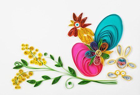 crafts with their hands of quilling on a holiday theme Happy Easter. Focus on eggs Stock Photo - 36538492
