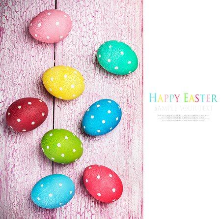 craquelure: colored Easter eggs on wooden background. The text serves as an example and can be easily removed Stock Photo
