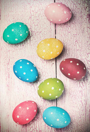 pascha: colored Easter eggs on wooden background. Focus on blue wooden background. toned photo Stock Photo