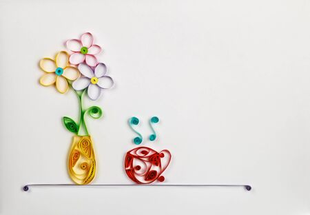 quilling: colorful flowers in a vase and a hot cup made of quilling. Location can be used for the text Stock Photo