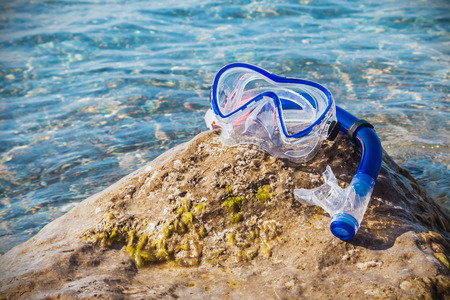 swim mask: mask for scuba diving and snorkel to swim at the beach. Focus on the mask Stock Photo