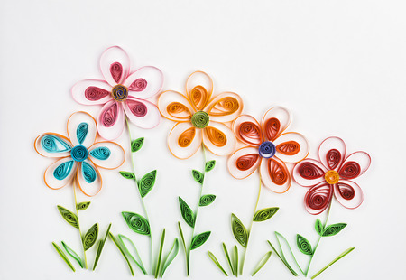 spring flowers made quilling on a light background