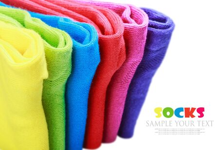 closer: colorful socks isolated on white background. Focus on purple-red sock, closer to the upper edge