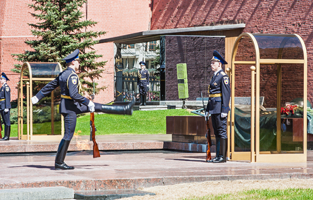 tomb of the unknown soldier: Russia Moscow Kremlin, May 2, 2013 - Honor Guard Standing near Eternal Fire and the tomb of Unknown Soldier under the wall of Moscow Kremlin, Russia