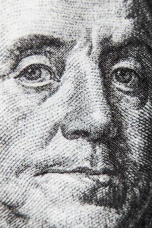 ben franklin money: macro of 100 dollar bill with Benjamin Franklin portrait. Very shallow depth of field, focus on left eye