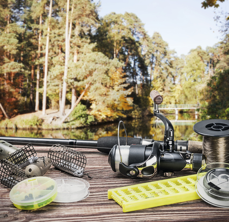 tackle: fishing tackle and accessories on the table autumn day