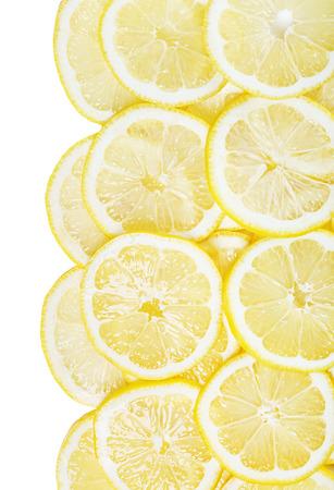background of heap fresh yellow lemon slices isolated on white background photo