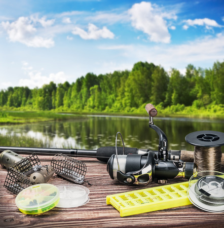 fishing tackle and accessories on the table summer day Imagens