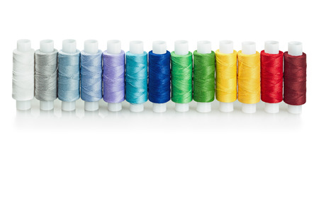 cotton thread: multicolored threads isolated on a white background