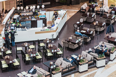 afimall: Moscow, Russia - April 19, 2015: buyers are resting in a cafe in Afimall City. Shopping complex Afimall City is located in Moscow City. Area of Afimall-320,000 square metres.focus in the center of the frame
