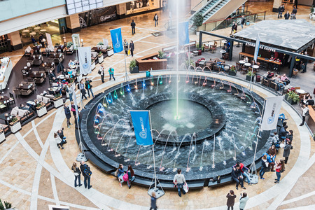 afimall: Moscow, Russia - April 19, 2015: shopping in Afimall City in Moscow. Shopping complex Afimall City is located in Moscow City. Area of Afimall-320,000 square metres.Focus on the fountain Editorial