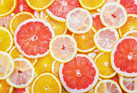 background with citrus-fruit of Fresh fruit slices photo