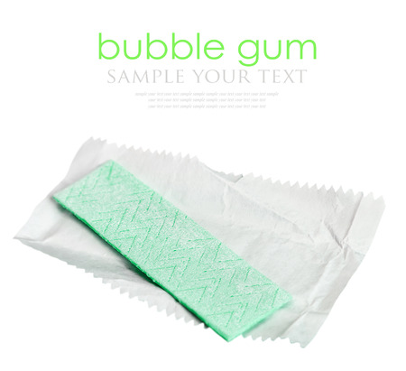 unpacked: chewing gum is on the white background with paper. focus in the middle of the frame, shallow depth of field