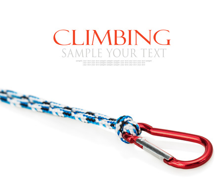 rapell: carabiner and rope climbing equipment isolated on a white background. Focus on the carabiner