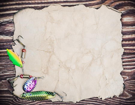spinner: Frame with spinner lures and old paper for text Stock Photo