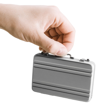 disclose: Female hand holds a small aluminum case. Focus on the hand Stock Photo