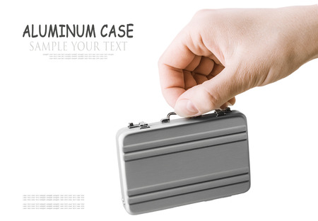 disclose: Female hand holds a small aluminum case. Focus on the hand. for example the text, can be easily removed