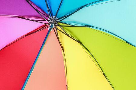 spokes: Colorful outdoor rainbow umbrella. Focus on the spokes of the umbrella