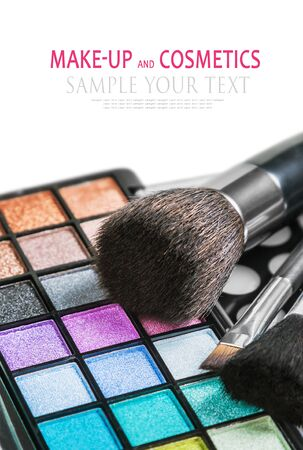 Colorful make-up and cosmetics isolated on a white background. Text example. Focus in the lower part of the frame on the blue shadows Stock Photo