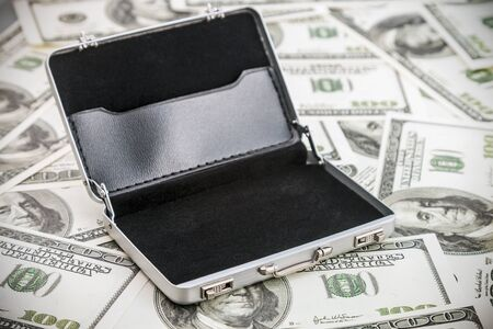 hard stuff: small aluminum case for the dollar. Focus on the handle of the case