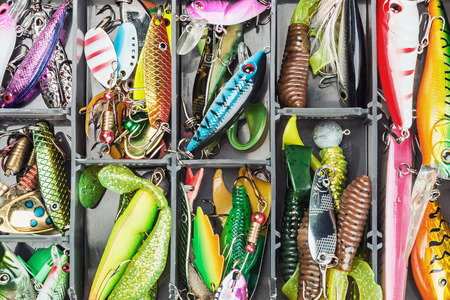 fishing catches: fishing lures and accessories in the box background