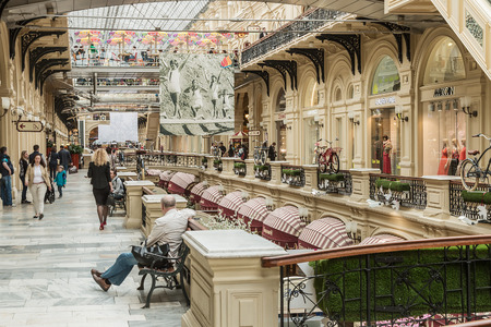 large store: Moscow, Russia - May 23, 2015: People in the cafe on the balcony in the GUM store in Moscow. GUM is the large store in the Kitai-gorod part of Moscow facing Red Square.