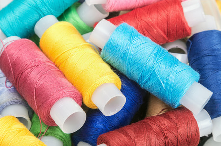 sewing cotton: Multicolor sewing threads on background. focus on strings in the center of the frame