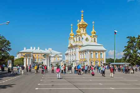 saints peter and paul: ST PETERSBURG, RUSSIA - JUNE 21, 2015: tourists at the Peterhof Church of Saints Peter and Paul. The Peterhof Palace included in the UNESCOs World Heritage List. Editorial