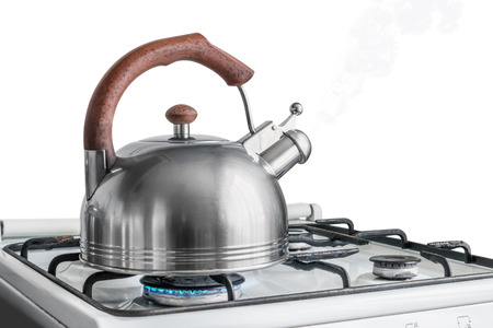 kettle boiling on a gas stove. Focus on a spout