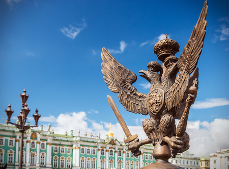 doubleheaded: Double-headed eagle in the imperial crown on the fence of the Alexander Column in St. Petersburg (focus at the eagle) Stock Photo